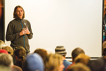 Brendan introducing a speaker during Alpenglow Mountain Festival 2014. Image from Tahoe Daily Tribune.