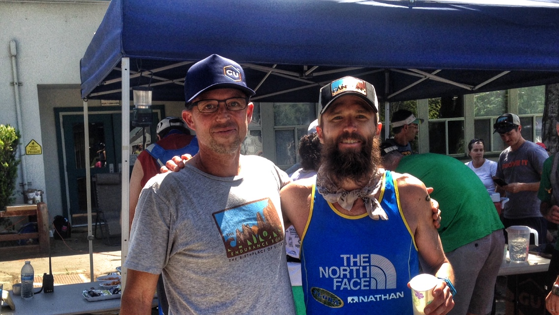 Race Director Chaz Sheya with Canyons 100k Champion Rob Krarr at the finish