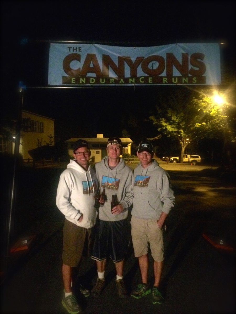 Chaz, Chris, and Pete greeting runners late into the night. Photo by Helen Pelster
