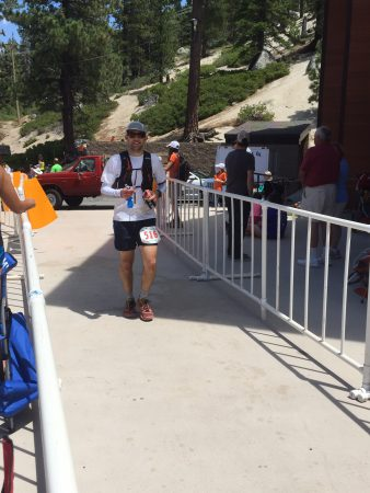 Eric coming into mile 30, happy to see his crew!