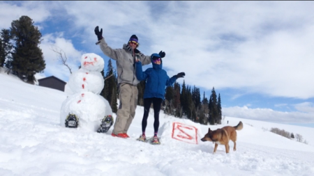 Anna Mae and JP made a snowman to cheer on racers. JP did most of the work. Photo by Anna Mae.